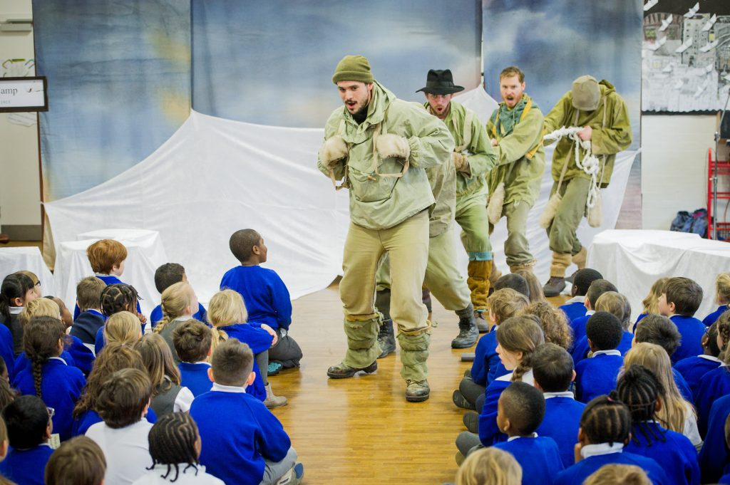 A group of primary school children watch an opera based on Shackleton's journey to the Antarctic